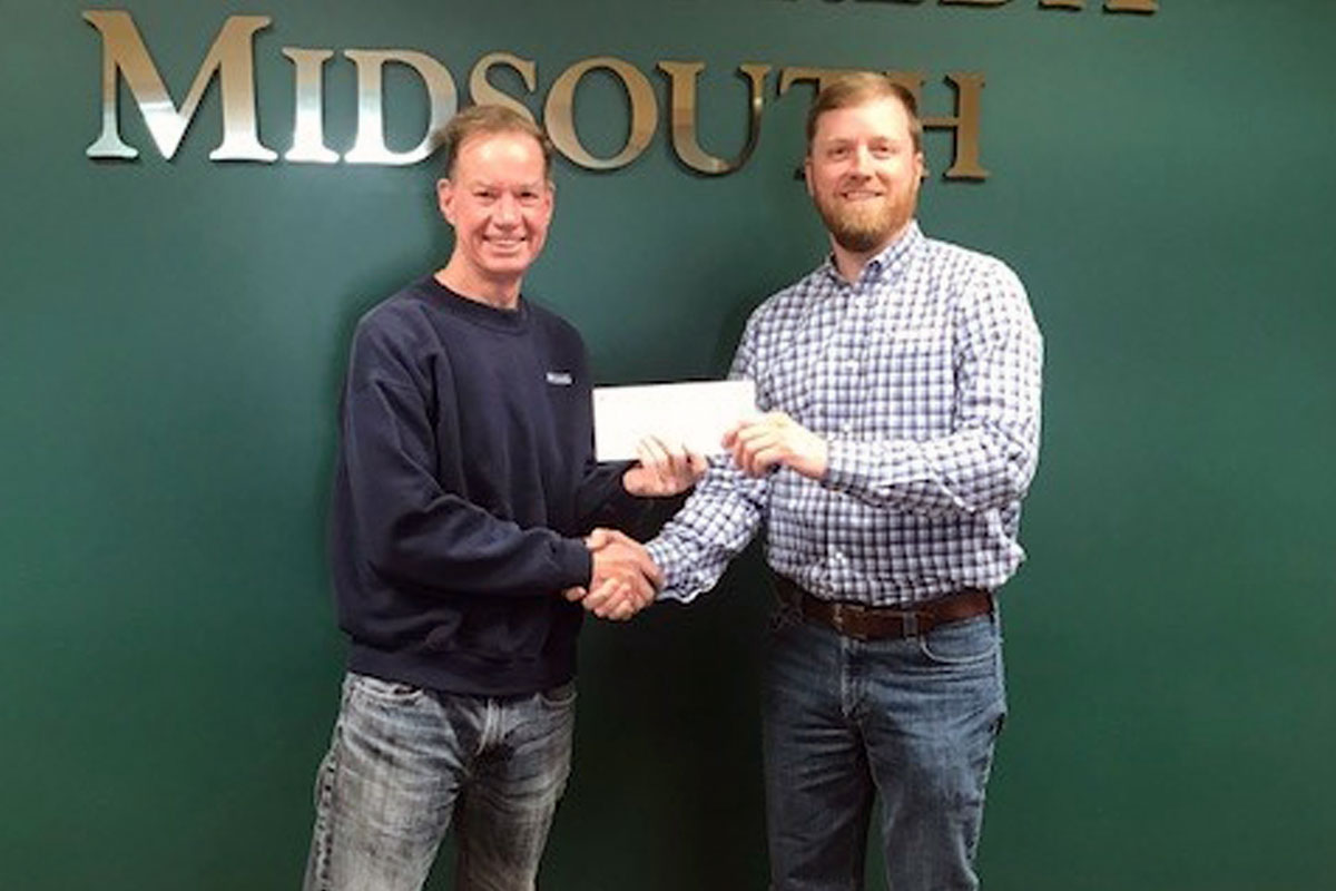 A farmer receiving their paytronage from Farm Credit Midsouth